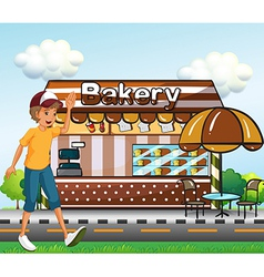 A boy walking across the bakery vector