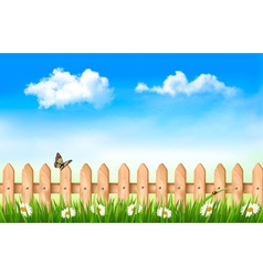 Wooden fence in grass with flowers and a butterfly vector