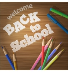 Back to school School supplies on a wooden board vector image