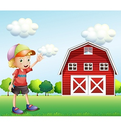A boy waving his hand near the barnhouse vector