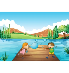 A young girl and boy playing with the bubbles vector image vector image