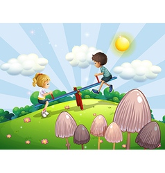 A boy and a girl riding a seesaw vector image vector image
