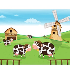 Goats at the farm with a windmill vector image vector image