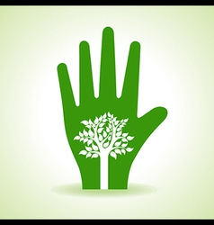 Tree inside the hand vector