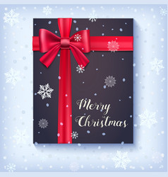Black gift box with red bow and ribbon on snow vector