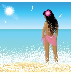 Young woman stands on the beach at sunset time vector