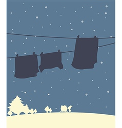 A shadow of hanging clothes in a winter season vector