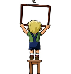boy hangs a picture vector image vector image