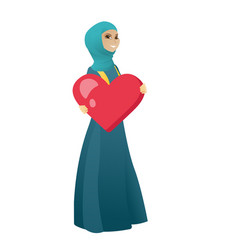 Muslim business woman holding a big red heart vector