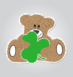 Cartoon - brown furry smiling bear with clover vector