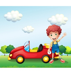 A boy waving his hand beside a car vector image vector image