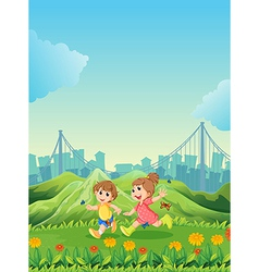 Two adorable kids playing with the butterflies vector image vector image