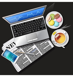 Laptop and phone with newspaper and tea macaroons vector