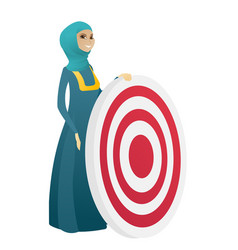 Young muslim business woman and dart board vector