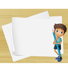 A kid holding a pencil beside the empty papers vector