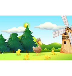 A duck and her ducklings near the wooden farmhouse vector