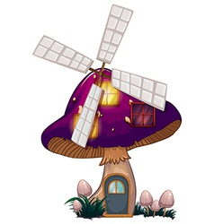A mushroom house with a windmill vector image vector image