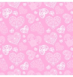 Openwork seamless pattern of hearts vector