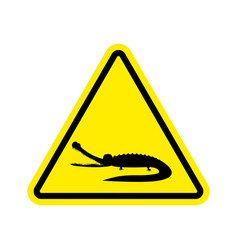 Attention crocodile alligator on yellow triangle vector