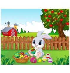 Cute easter bunny painting an egg in the garden vector