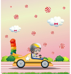 A boy riding on a car vector image
