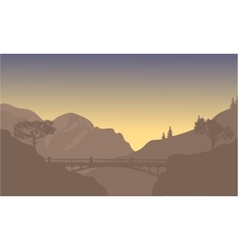 Bridge silhouette with brown background vector