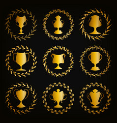 Golden shields with laurel wreaths cups vector