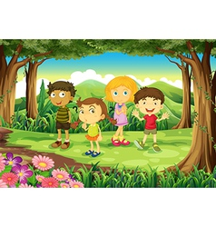 A forest with four kids vector image vector image