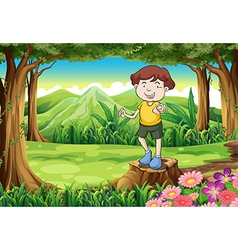 A young gentleman standing above the stump vector image