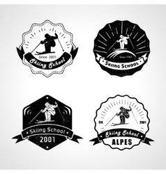 Set of skiing logos emblems and design vector