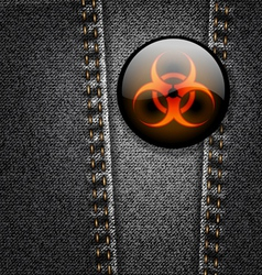 Biohazard badge on black denim texture vector