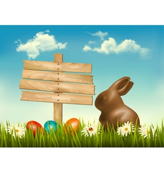Chocolate bunny with easter eggs and a sign in a vector