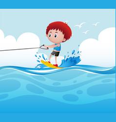 Boy playing water ski in the ocean vector