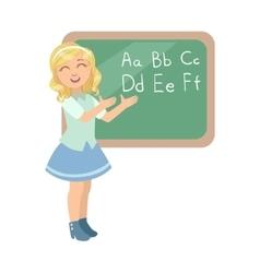 Girl In School Uniform Standing Next To Blackboard vector image