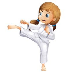 An energetic young woman doing karate vector