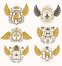 Heraldic emblems with wings isolated on white vector