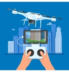 Drone with remote control flying over city Aerial vector image vector image