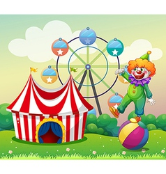 A clown standing above the ball at the carnival vector