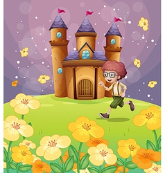 A boy running in front of the castle with flowers vector