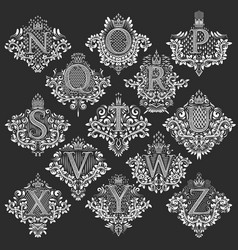Set of heraldic monograms in coats of arms form vector