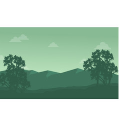Silhouette of mountain with tree scenery vector