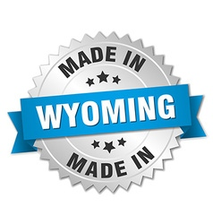 Made in wyoming silver badge with blue ribbon vector