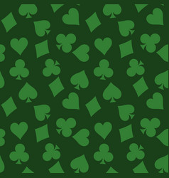 Seamless pattern background of green poker suits - vector