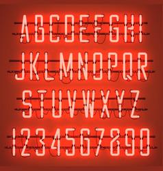 Glowing orange neon casual script font vector