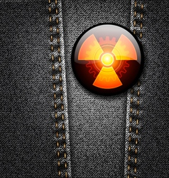 Radioactivity badge on black denim vector