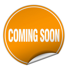 Coming soon round orange sticker isolated on white vector