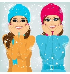 Two attractive brunette women friends outdoors vector