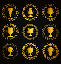 golden shields with laurel wreaths cups vector image