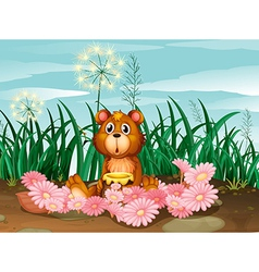 A cute bear with pink flowers vector image vector image