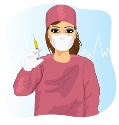 Female doctor in face mask holding a syringe vector